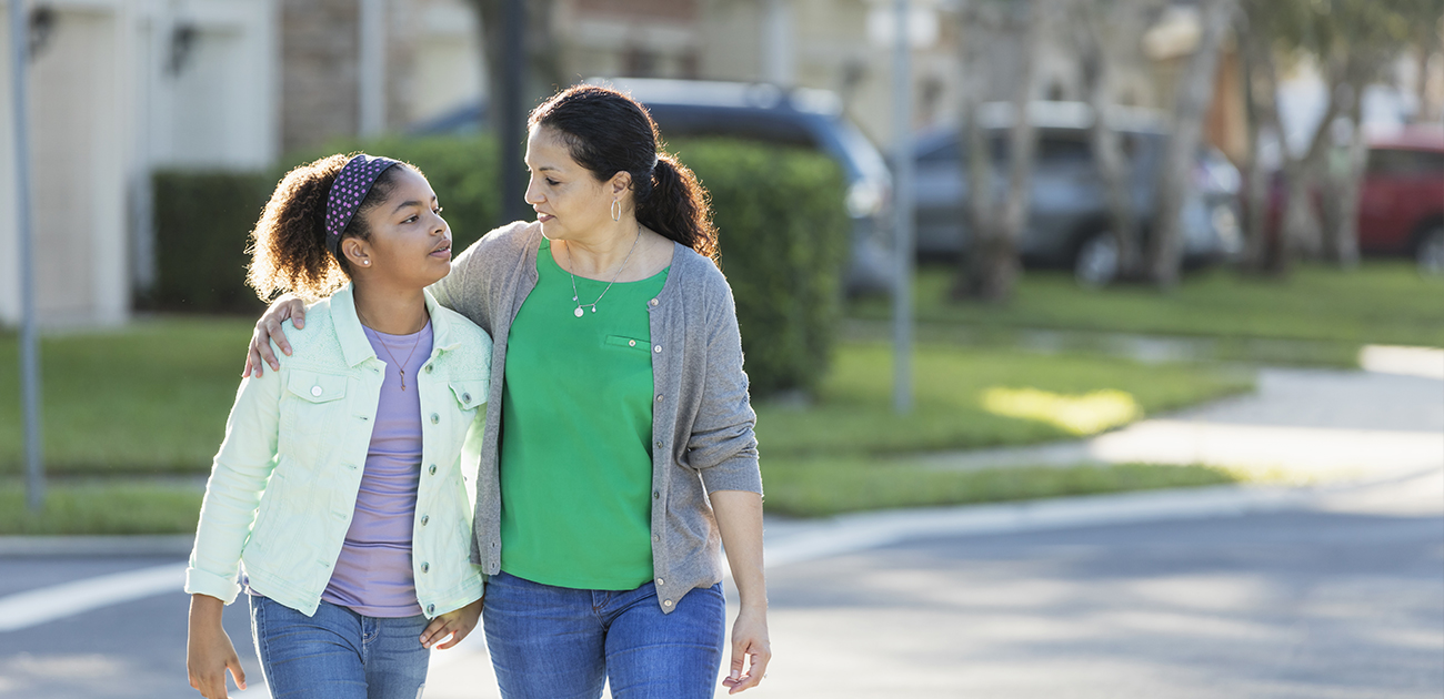 Mom and Daughter Walking in a neighborhood