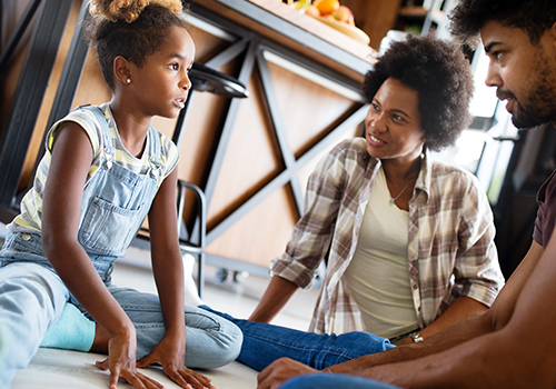Girl listening intently during a family discussion